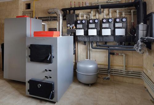 Монтаж твердотопливного отопления в частном доме в Королёве